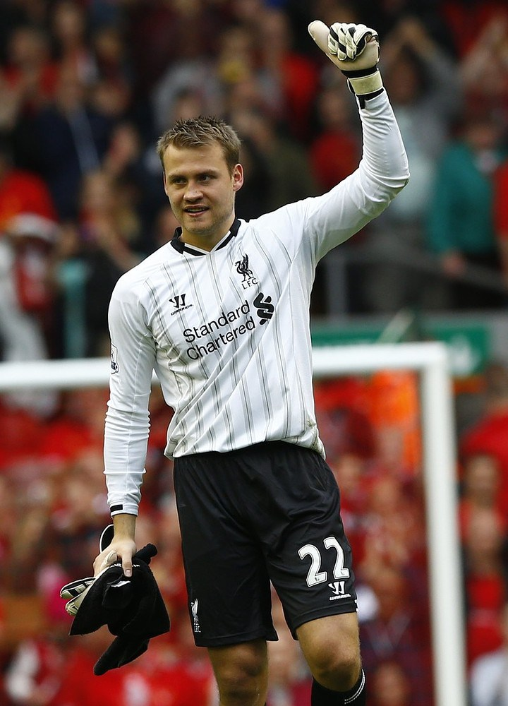 Liverpool goalkeeper Simon Mignolet gestures after their English Premier League soccer match against Stoke City at Anfield in Liverpool