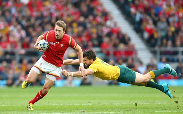 Mandatory Credit: Photo by Matthew Impey/REX Shutterstock (5226365aq) Liam Williams of Wales gets away from the diving Adam Ashley-Cooper of Australia. Australia v Wales, Rugby World Cup, Rugby Union, Twickenham, Britain - 10/10/2015