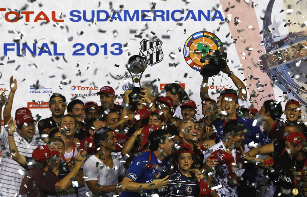 Argentina's Lanus soccer team celebrates with trophy after defeating Brazil's Ponte Preta in final Copa Sudamericana match in Buenos Aires